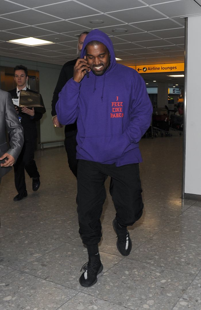 Kanye West arriving at Heathrow Airport all smiles. Kanye was wearing an as yet unreleased pair of his Yeezy Boost 350 trainers, as well as a Pablo hoodie, to promote his new album Featuring: Kanye West Where: London, United Kingdom When: 10 Apr 2016 Credit: Will Alexander/WENN.com