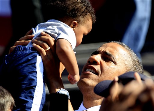 President Barack Obama holds a baby as he greets supporters during a campaign rally in Byrd Park in Richmond, Va., Thursday, Oct. 25, 2012. The president is on the second day of his 48 hour, 8 State campaign blitz. (AP Photo/Steve Helber)