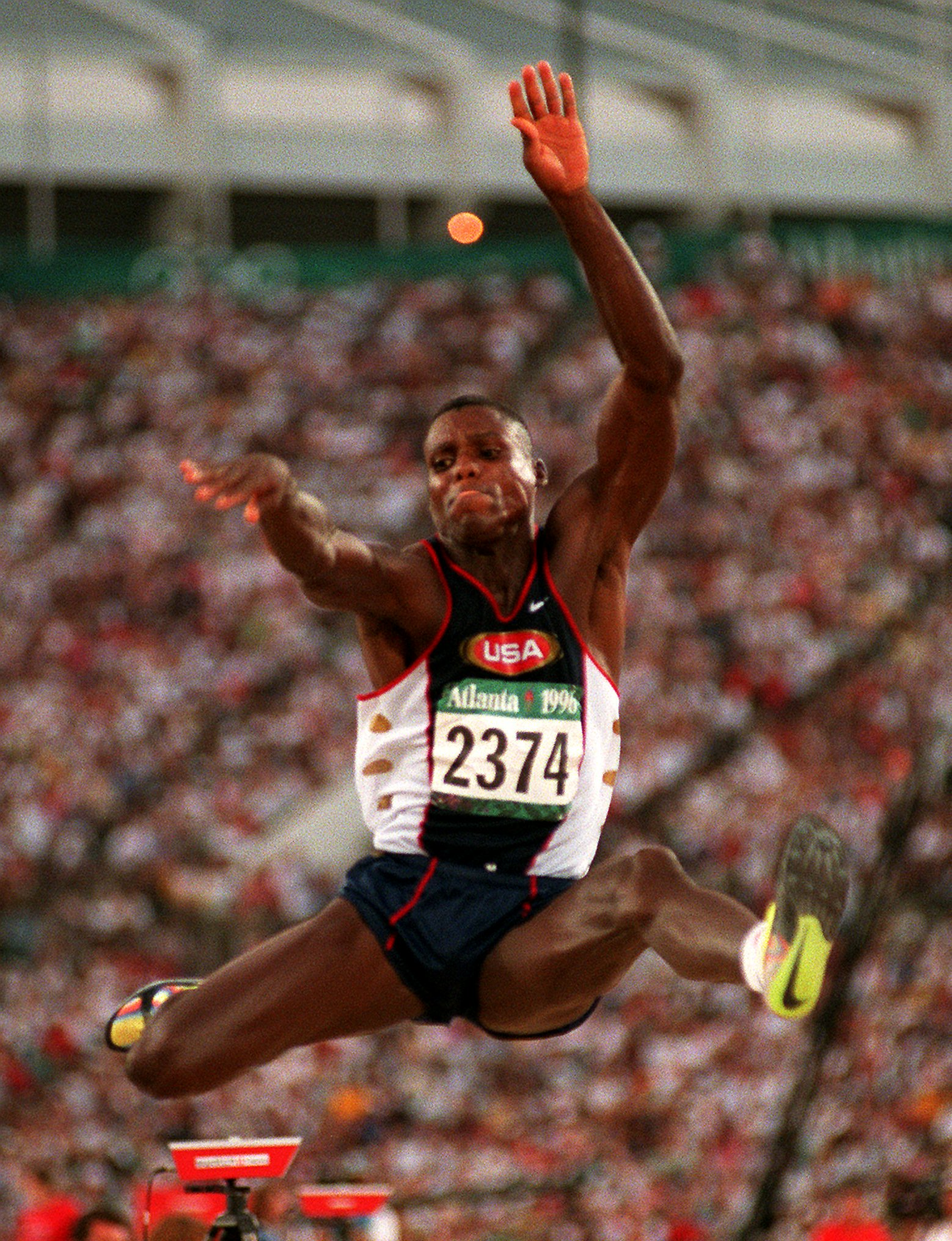 Carl Lewis of the United States takes his third jump during the men's long jump final at the 1996 Summer Olympic Games in Atlanta, Monday, July 29, 1996. Lewis won the gold medal. (AP Photo/Lynne Sladky)