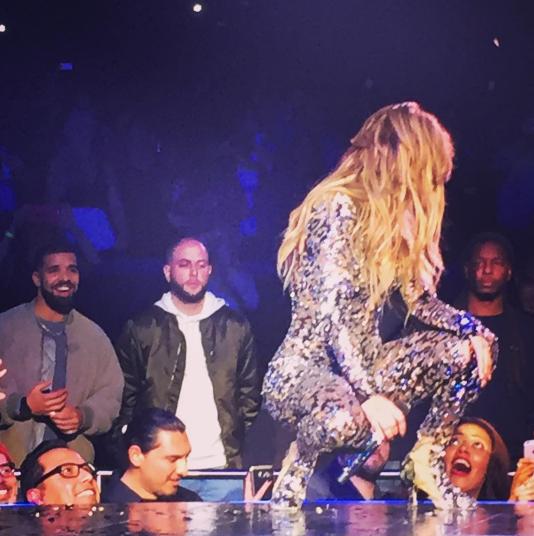 Drake looks at Jennifer Lopez