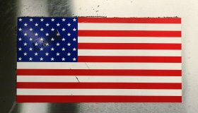 Close-Up Of American Flag On Metal