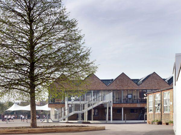 Classroom exterior. Whitehorse Manor Junior School at Pegaus Academy, Thornton Heath, United Kingdom. Architect: Hayhurst and Co., 2014.