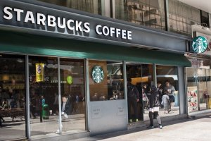 A customer having coffee at a Starbucks coffee establishment...