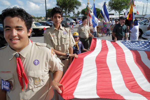 Boy scouts marching with a flag at Arts in the Street, Independence of Central America & Mexico Cultural Integration Day.