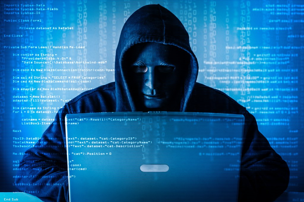 The abstract image of the hacker wear a mask using a laptop in the empty white room overlay with source code hologram. the concept of cyber attack, virus, malware, illegally and cyber security.