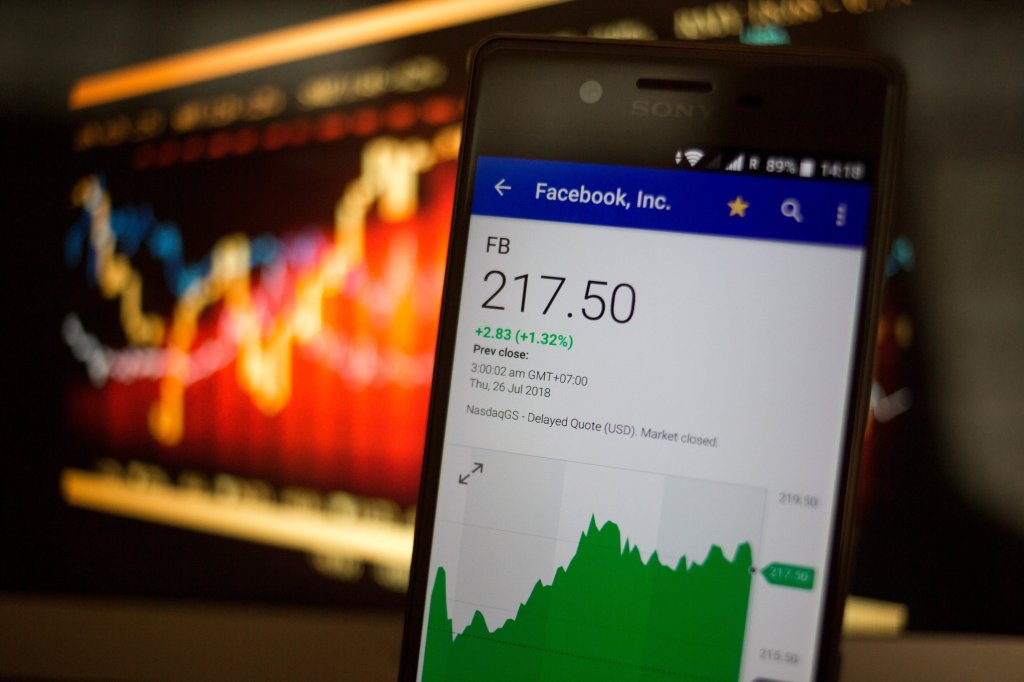 A smartphone displays the Facebook, Inc. market value on the...