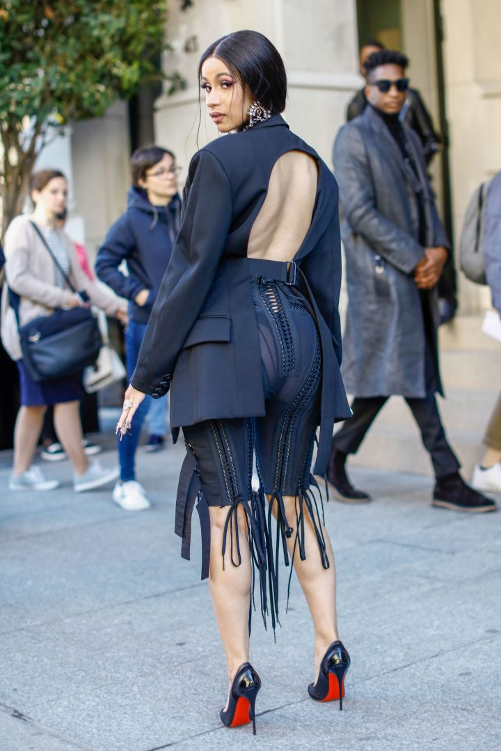 Cardi B poses in a daring all black look.