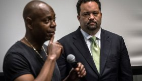 Comedian Dave Chappelle, left, stumps with childhood friend and former NAACP president Ben Jealous, right, at an early voting rally at Morgan State University in Baltimore, Maryland...