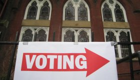 A sign pointing to a polling station is