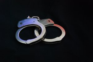 High Angle View Of Hand Cuffs On Black Background
