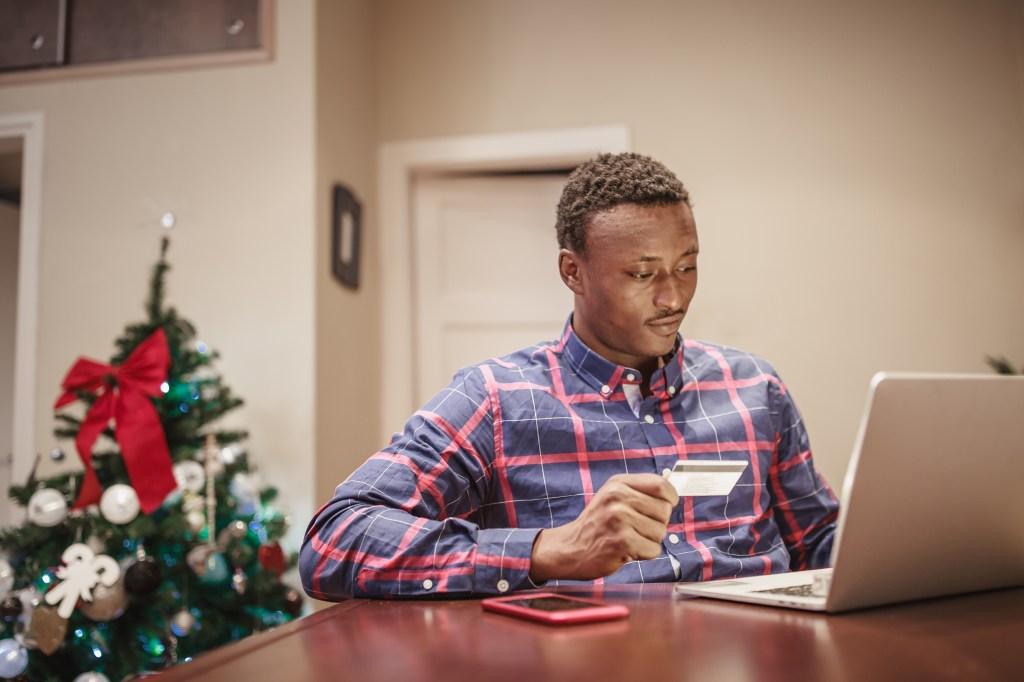 African men shopping Christmas present online