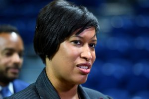 DC Mayor Bowser leads a tour at the Ward 8 Sports and Entertainment arena