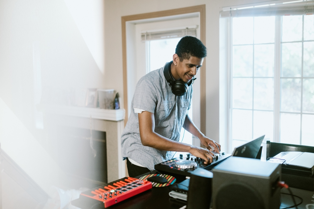 Young Adult Man Practicing His Live DJ Set at Home