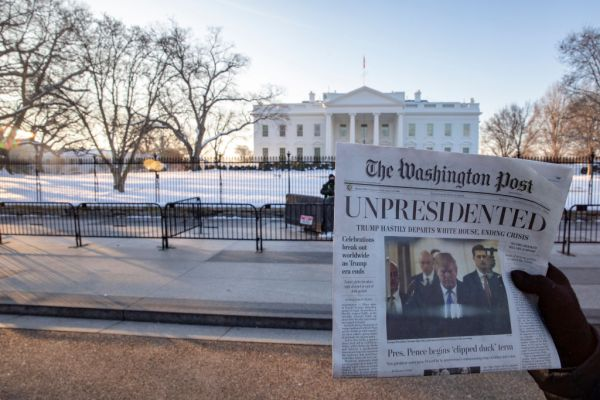Activists Distribute 'Bye-Bye 45' A Satire Edition Of The Washington Post