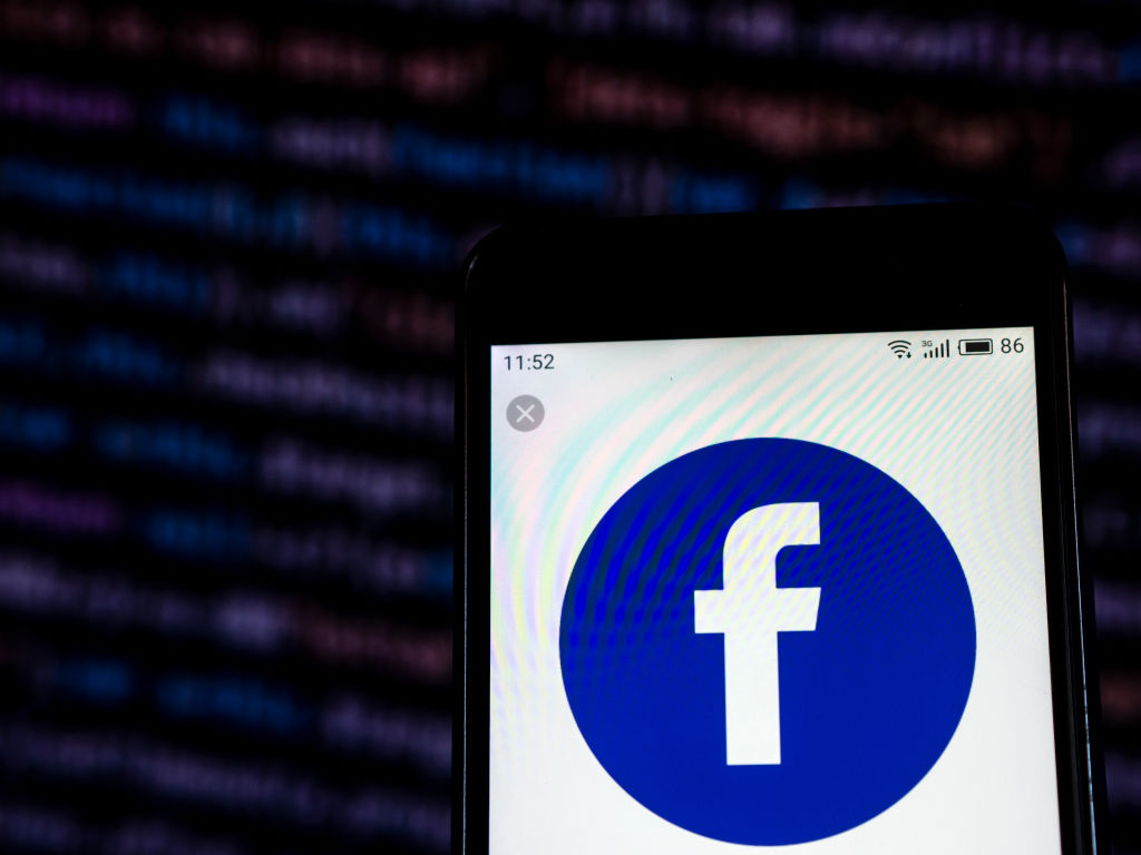 Facebook logo seen displayed on a smart phone...