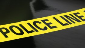Police Caution Tape on a black background
