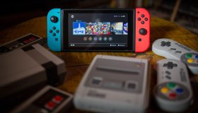 A Nintendo Switch (M) surrounded by a NES (Nintendo...