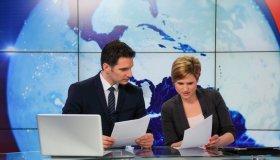 Journalists preparing in a tv news studio
