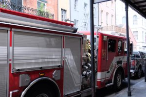 Fire Truck By Footpath In City