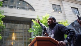Rapper Meek Mill addresses a rally outside the courthouse...