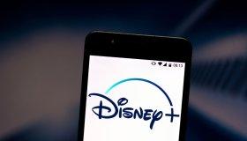 In this photo illustration a Disney+ (Plus) logo seen...