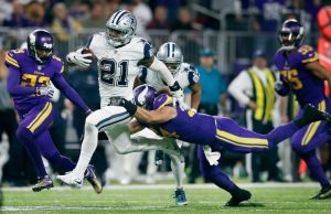 Dallas Cowboys running back Ezekiel Elliott (21) picked up a first down and was tackled by Minnesota Vikings middle linebacker Eric Kendricks (54) in the forth quarter at U.S. Bank Stadium Thursday December 01,2016 in Minneapolis MN. The Minnesota Viking