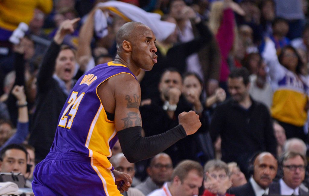 Los Angeles Lakers' Kobe Bryant (24) pumps his fist after sinking a three-pointer in overtime against the Golden State Warriors during their game at Oracle Arena in Oakland, Calif. on Saturday, Dec. 22, 2012. Los Angeles defeated Golden State 118-115 in o
