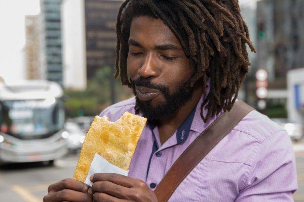 Close-Up Of Man Eating Food