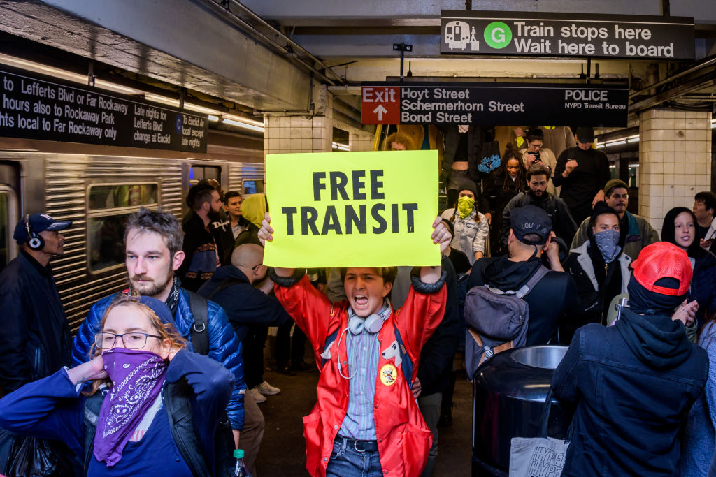 Hundreds of protesters took over a subway platform in...