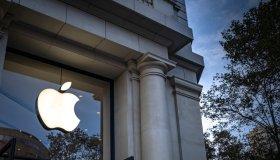 Apple's popular Apple logo, an American company that designs...