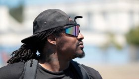 Marshawn Lynch, Seattle Seahawks running back and former Oakland Tech High football star, keeps an eye on the action at the Fam 1st Family Foundation's annual youth football camp at Oakland Tech High School in Oakland, Calif., on Saturday, July 13, 2013.