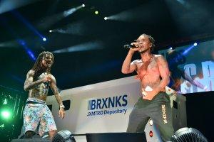 Wiz Khalifa and Rae Sremmurd perform on stage at Perfect Vodka Amphitheater