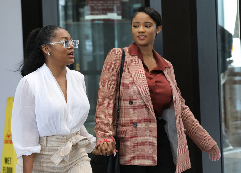 R. Kelly's girlfriends clash at Trump Tower in Chicago, sending one to a hospital while other is charged with domestic batteru