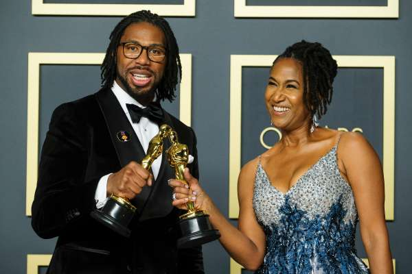 Matthew A. Cherry & Karen Rupert Toliver poses with the Oscar for Short Film (Animated) in the film Hair Love during the the 92nd Academy Awards, 2020 on Sunday 9 February 2020