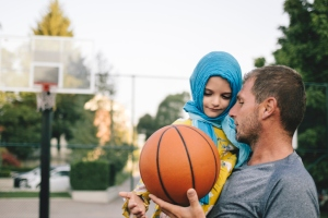 Father And Child Playing Basketball