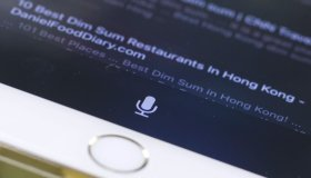 This image shows a detail of iPhone 7 smartphone screen showing Siri voice control button. 27OCT16 SCMP/May Tse [31OCTOBER2016 FEATURES DIGITAL]