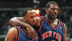 005674.SP.0402.lakers3–– The Knicks Larry Johnson(right) consols teammate Chris Childs as he leads h