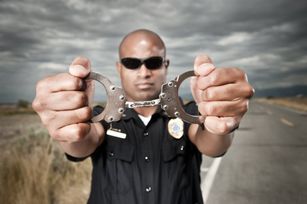 Police Officer Showing Handcuffs