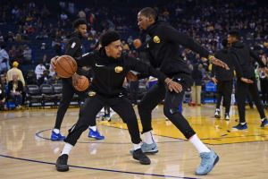 Golden State Warriors' Quinn Cook (4) warms up with teammate Kevin Durant (35) before their NBA game against the Brooklyn Nets at the Oracle Arena in Oakland, Calif. on Saturday, Nov. 10, 2018. (Jose Carlos Fajardo/Bay Area News Group)