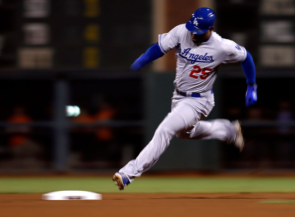Los Angeles Dodgers' Carl Crawford (25) rounds second base on his way to third for a triple against the San Francisco Giants in the first inning at AT&T Park, Calif. on Thursday, Sept. 26, 2013. (Nhat V. Meyer/Bay Area News Group)