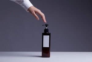 Human Hand Touch Shampoo Or Lotion Or Dishwashing Liquid In Pump Bottle,Product Shot.