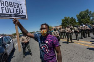 Black Lives Matter Protestors Rally In CA After Black Man Found Dead By Hanging