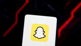 In this photo illustration a Snapchat logo seen displayed on...
