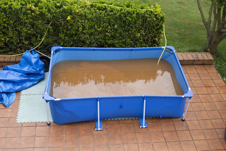 Brown water in swimming pool