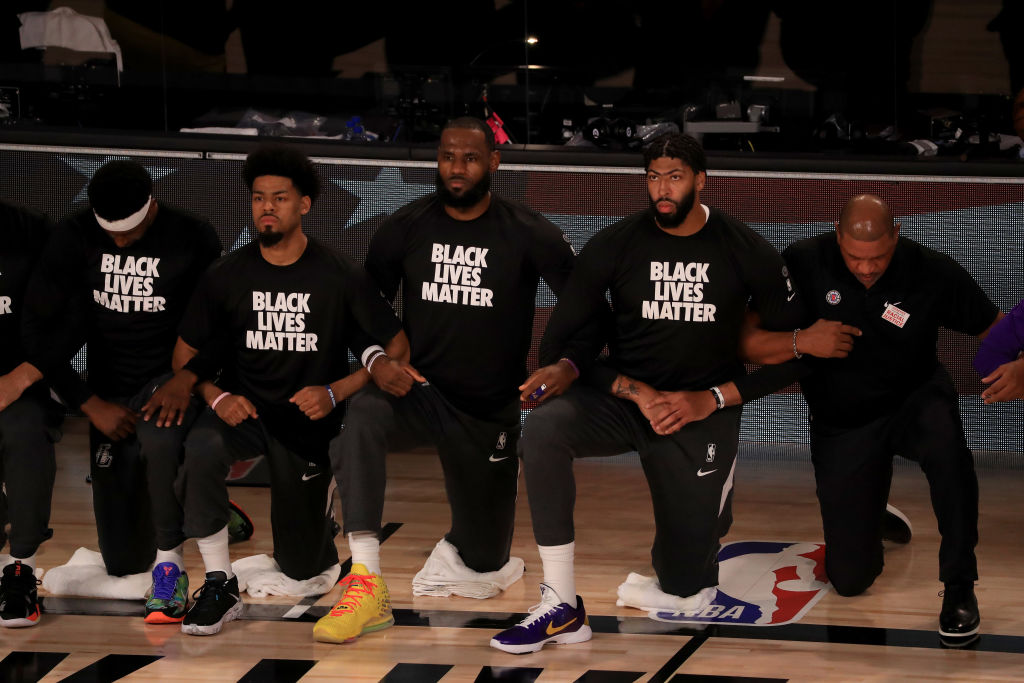 LeBron James & Other NBA Superstars Kneel During National Anthem