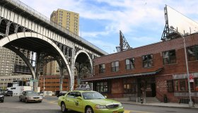 """Green taxi cab (so called """"boro cab"""") by the 125th Street Viaduct in Harlem, Manhattan, New York City"""