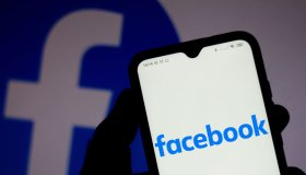 In this photo illustration a Facebook logo seen displayed on...