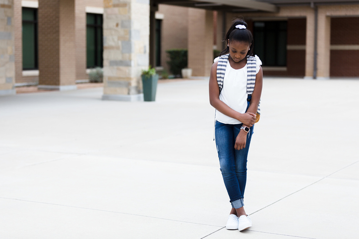 Lonely schoolgirl on campus