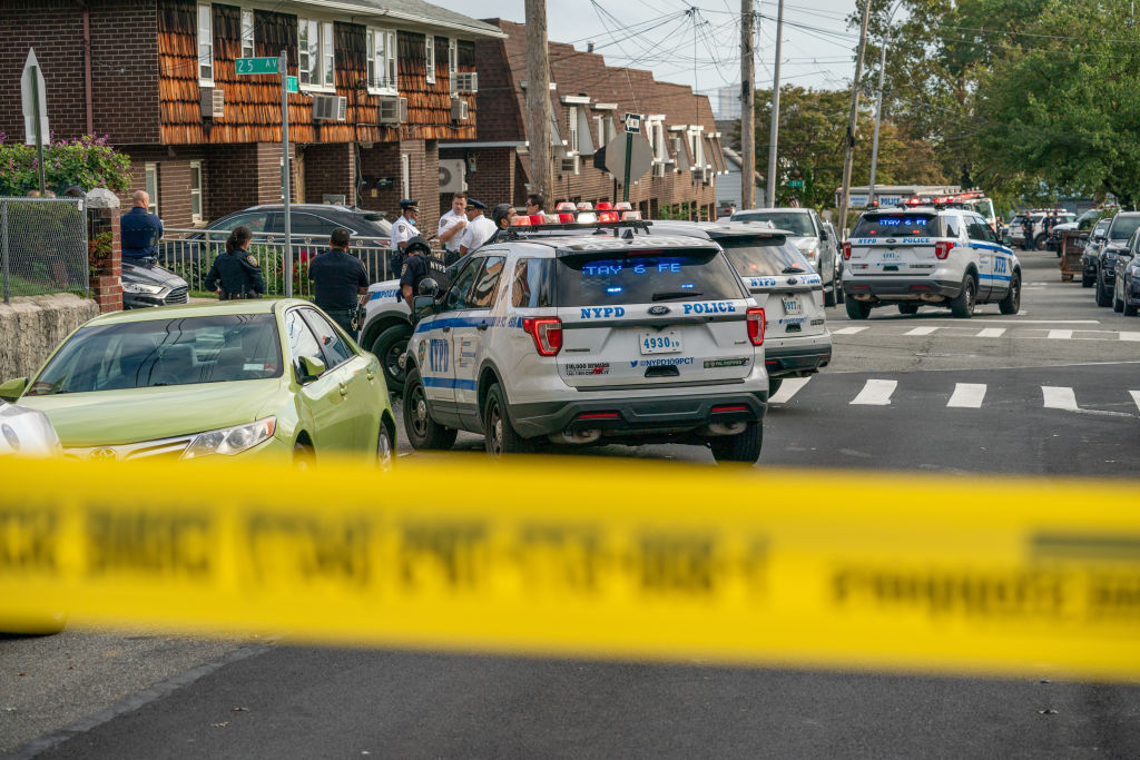 NYPD car seen on the shooting scene. Police from 109th...