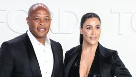 Dr. Dre and Nicole Young arrive at the Tom Fo...